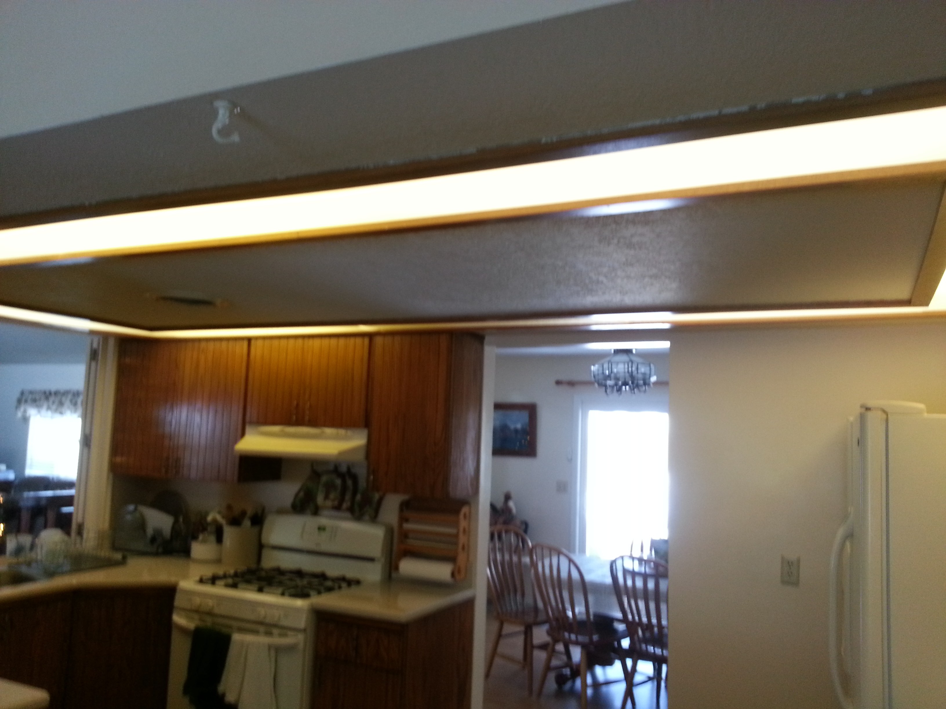 Kitchen drop ceiling lighting - Before This Outdated Lighting And Drop Ceiling Was A Drab And Needed To Go